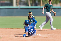 Oakland Athletics second baseman Jeremy Eierman (10) applies the tag to Kenneth Betancourt (60) on a stolen base attempt during an Instructional League game against the Los Angeles Dodgers at Camelback Ranch on September 27, 2018 in Glendale, Arizona. (Zachary Lucy/Four Seam Images)