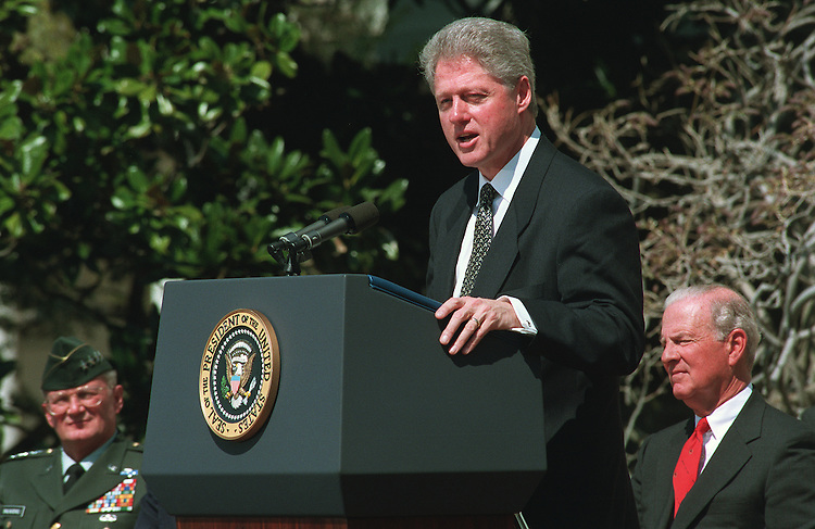 4/4/97.President Bill Clinton at White House event to discuss the importance of ratifying the chemical weapons convention treaty. At left is Chairman of the Joint Chiefs of Staff John Shalikashvili. At right is former Secretary of State James Baker. White House, South Lawn..PHOTO BY SCOTT J. FERRELL