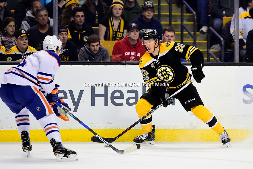 Thursday, January 5, 2017: Boston Bruins center Riley Nash (20) looks to pass the puck by Edmonton Oilers defenseman Kris Russell (4) during the National Hockey League game between the Edmonton Oilers and the Boston Bruins held at TD Garden, in Boston, Mass. Edmonton defeats Boston 4-3 in regulation time. Eric Canha/CSM