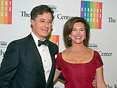 Steven Colbert and his wife, Evelyn McGee-Colbert arrive for the formal Artist's Dinner honoring the recipients of the 2014 Kennedy Center Honors hosted by United States Secretary of State John F. Kerry at the U.S. Department of State in Washington, D.C. on Saturday, December 6, 2014. The 2014 honorees are: singer Al Green, actor and filmmaker Tom Hanks, ballerina Patricia McBride, singer-songwriter Sting, and comedienne Lily Tomlin.<br /> Credit: Ron Sachs / Pool via CNP