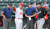 April 28, 2009: Greenville Drive manager Kevin Boles, second from right, points out the ground rules prior to a game against the Savannah Sand Gnats at Fluor Field at the West End in Greenville, S.C. From left are umpire Randy Burgess, Boles, umpire Jason Hutchings and Savannah manager Edgar Alfonzo. Photo by: Tom Priddy/Four Seam Images