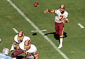 Washington Redskins quarterback Joe Theismann (7) passes the ball during the game against the Houston Oilers at RFK Stadium in Washington, DC on September 16, 1985.  Blocking for Theismann are offensive guard R.C. Thielemann (69) and left tackle Joe Jacoby (66). Defending for Houston is right defensive end Jesse Baker (75).  The Redskins won the game 16 - 13.<br /> Credit: Howard L. Sachs / CNP
