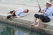 """United States Representative Jack Kingston (Democrat of Georgia) catches a big """"fish"""", Stephen Colbert, host of the Comedy Central show """"The Colbert Report"""" at the U.S. Capitol Reflecting Pool in Washington, D.C. on Friday, October 3, 2014.<br /> Credit: Ron Sachs / CNP<br /> (RESTRICTION: NO New York or New Jersey Newspapers or newspapers within a 75 mile radius of New York City)"""