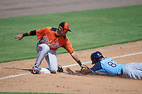 Baltimore Orioles Alejandro Juvier (3) tags Joseph Astacio (83) sliding into third during an instructional league game against the Tampa Bay Rays on September 25, 2015 at Ed Smith Stadium in Sarasota, Florida.  (Mike Janes/Four Seam Images)