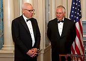 David M. Rubenstein, Chairman, John F. Kennedy Center for the Performing Arts, left, and United States Secretary of State Rex Tillerson, right, in discussion prior to the five recipients of the 40th Annual Kennedy Center Honors posing for a group photo following a dinner hosted by Secretary Tillerson in their honor at the US Department of State in Washington, D.C. on Saturday, December 2, 2017.   <br /> Credit: Ron Sachs / Pool via CNP