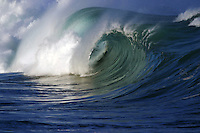This large swell is curling over on the North Shore of Oahu, Hawaii.