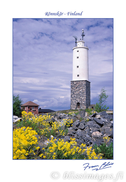 Vibrant spring wildflowers grace the foreground of Rönnskär, a present-day military lighthouse in the archipelago islands of southern Finland.