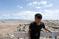 "Photographer Sze Tsung Leong shooting part of his ""Horizons"" series on an 8x10 camera. Bordo de Xochiaca, Mexico City's largest garbage dump."