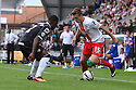 Luke Freeman of Stevenage takes on Mustapha Dumbuya of Notts County<br />  - Notts County v Stevenage - Sky Bet League One - Meadow Lane, Nottingham - 24th August 2013<br /> © Kevin Coleman 2013