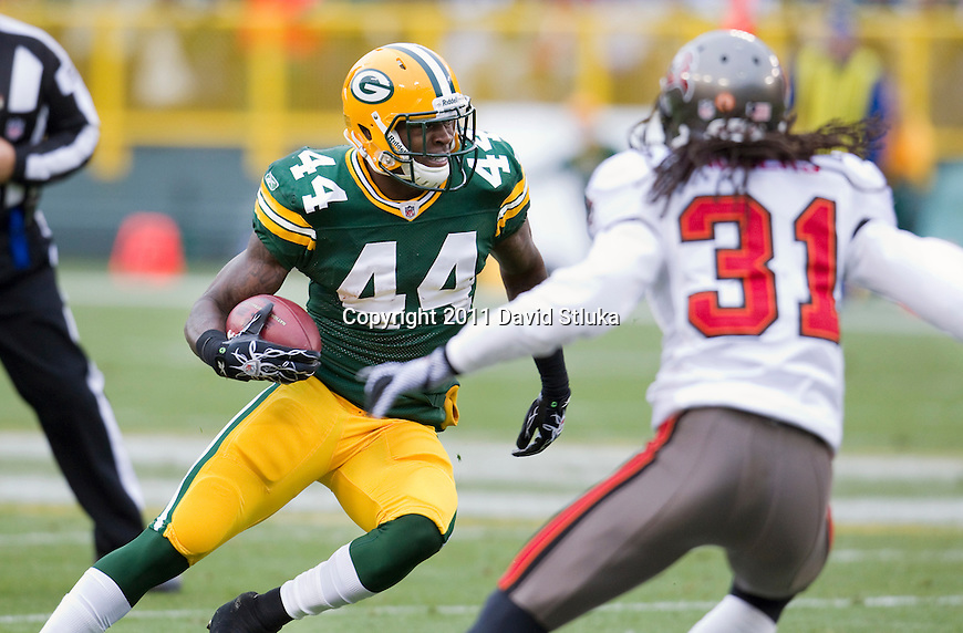 Green Bay Packers running back James Starks (44) carries the ball during a Week 11 NFL football game against the Tampa Bay Buccaneers on November 20, 2011 in Green Bay, Wisconsin. The Packers won 35-26. (AP Photo/David Stluka)
