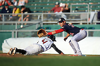 Peoria Chiefs first baseman Alex De Leon (34) stretches for a throw as Tim Locastro (4) dives back to the bag on a pick off attempt during a game against the Lansing Lugnuts on June 6, 2015 at Cooley Law School Stadium in Lansing, Michigan.  Lansing defeated Peoria 6-2.  (Mike Janes/Four Seam Images)