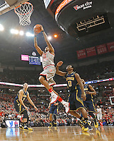 Ohio State Buckeyes forward LaQuinton Ross (10) goes up for a dunk against Michigan Wolverines guard Derrick Walton Jr. (10) in the first half at Nationwide Arena on February 11,  2014. (Chris Russell/Dispatch Photo)