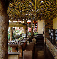 An outdoor dining area with a table made of local rough-hewn wood
