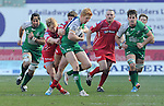 Connacht's Darragh Leader is tackled by Scarlets' Aled Davies and Regan King<br /> <br /> Rugby - Scarlets V Connacht - Guinness Pro12 - Sunday 15th Febuary 2015 - Parc-y-Scarlets - Llanelli<br /> <br /> &copy; www.sportingwales.com- PLEASE CREDIT IAN COOK