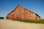 Red barn covered with with old farm tools along route 148 at the Louis Holste farm in southwest Iowa.