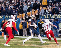 Pitt wide receiver Dontez Ford makes a 32-yard touchdown catch as Louisiville Cardinal defensive back Josh Harvey-Clemons and Jermaine Reve pursue. The Pitt Panthers football team defeated the Louisville Cardinals 45-34 on Saturday, November 21, 2015 at Heinz Field, Pittsburgh, Pennsylvania.