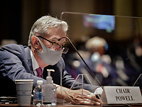 Jerome H. Powell, Chair of the Board of Governors of the Federal Reserve System, adjusts his nameplate before the House Committee on Financial Services hearing on Oversight of the Treasury Department and Fed Reserve Pandemic response in Washington, DC on June 30, 2020.<br /> Credit: Bill O'Leary / Pool via CNP /MediaPunch