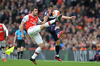 Sokratis Papastathopoulos of Arsenal FC and Aaron Cresswell of West Ham United during Arsenal vs West Ham United, Premier League Football at the Emirates Stadium on 7th March 2020