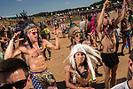 09/28/13 - A group of students from New Jersey wearing native American headdresses dance together near the main stage. The TomorrowLand festival is an electronic musis festival that started in Belgium and one of the largest in the world. This is the first time it has ever been brought to the U.S. and it's being called TomorrowWorld.<br /> <br /> CREDIT: Raymond McCrea Jones for Atlanta Magazine
