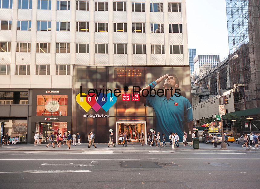 The Uniqlo store on Fifth Avenue in New York is decorated with a mural feating top seed tennis player Novak Djokovic, seen on Monday, August 29, 2016. The U.S. Open starts today in Queens and Uniqlo sponsors Djokovic. (©Richard B. Levine)
