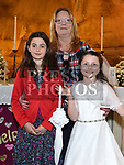 Emily Gilson from St Brigids school who recieved first holy communion in Our Lady of Lourdes church with grandmother Philomena Gilson and Cousin Samala Hutchinson. Photo:Colin Bell/pressphotos.ie