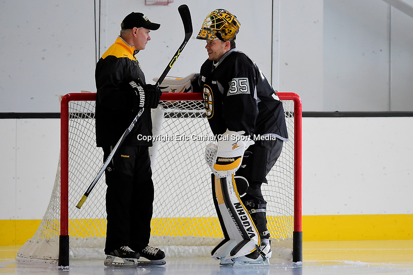 Friday, September 23, 2016: Boston Bruins goalie Anton Khudobin (35) speaks to a member of the coaching staff during the Boston Bruins training camp held at Warrior Ice Arena, in Brighton, Mass. Eric Canha/CSM