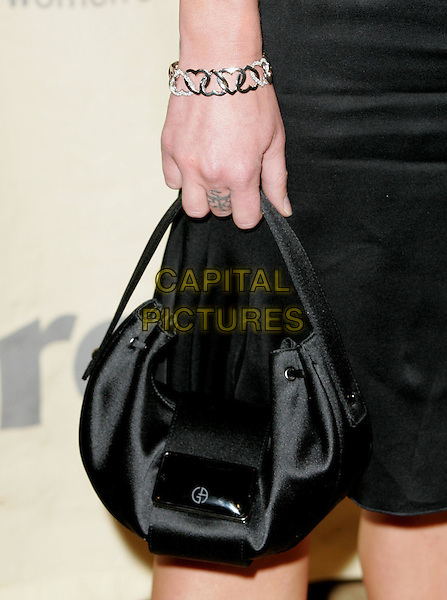 "PORTIA DE ROSSI.Attend ""A Family Affair: Women in Film celebrates The Paltrow Family"" 2004 Crystal & Lucy Awards held at The Westin Century Plaza Hotel in Century City, California.June 18, 2004.bag, purse, bracelet, hearts.www.capitalpictures.com.sales@capitalpictures.com.©Debbie VanStory/Capital Pictures.."