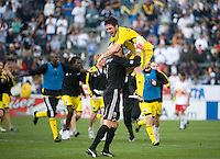 Danny O'Rourke jumps into goalie William Hesmer's arms to celebrate Columbus' victory at MLS Cup 2008. Columbus Crew defeated the New York Red Bulls, 3-1, Sunday, November 23, 2008. Photo by John Todd/isiphotos.com