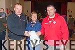 Mary Keating from the Fisherman's Bar Portmagee presenting Declan O'Leary(Skellig Rangers Junior Trainer) & Mike Brennan(Senior Trainer) with a set of 36 Football Shorts and Socks for the 2015 season.