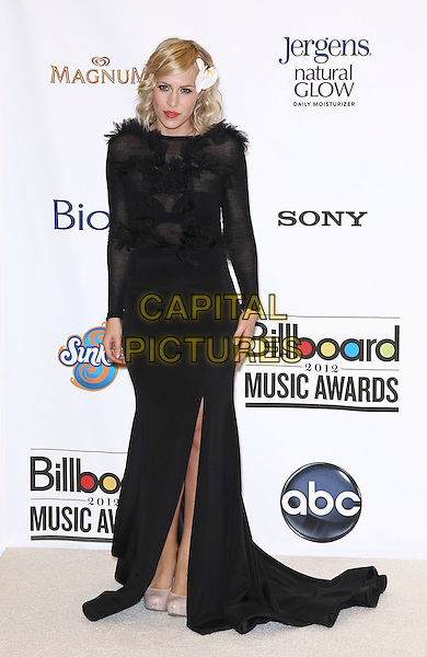 Natasha Bedingfield.2012 Billboard Music Awards Press Room at the MGM Grand Garden Arena Las Vegas, Las Vegas, Nevada, USA..May 20th, 2012.full length black dress feathers slit split.CAP/ADM/MJT.© MJT/AdMedia/Capital Pictures.