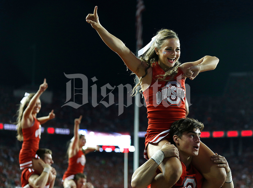 Cheerleaders during Saturday's NCAA Division I football game at Ohio Stadium in Columbus on September 27, 2014. (Columbus Dispatch photo by Jonathan Quilter)