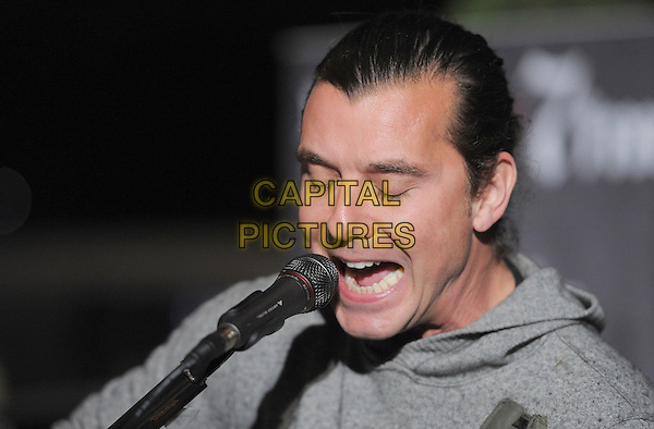 Gavin Rossdale.98.7FM Presents Bush  in an exclusive live performance at the 98.7FM Penthouse inside the Historic Hollywood Tower in Hollywood, California, USA..January 31st, 2012     .on stage in concert live gig performance performing music headshot portrait grey gray singing                                                                            .CAP/RKE/DVS.©DVS/RockinExposures/Capital Pictures.