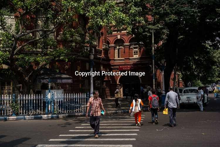 A pedestrian crosses the street outside the Writers Building, the secretariat building of the State Government of West Bengal in BBD Bagh in Kolkata, West Bengal  on Friday, May 26, 2017. Photographer: Sanjit Das