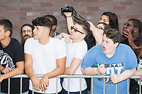 Fans wait outside the VIP entrance to get a glimpse of wrestlers before a WWE Live Summerslam Heatwave Tour event at the MassMutual Center in Springfield, Massachusetts, USA, on Mon., Aug. 14, 2017.