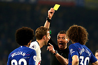 Referee Andre Marriner shows a yellow card to Harry Kane of Tottenham Hotspur and David Luiz of Chelsea during Chelsea vs Tottenham Hotspur, Premier League Football at Stamford Bridge on 27th February 2019