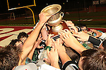Redondo Beach, CA 05/11/10 - Mira Costa players reach to touch the championship trophee after winning the 2010 Los Angeles Boys Lacrosse Championship game against Palos Verdes.