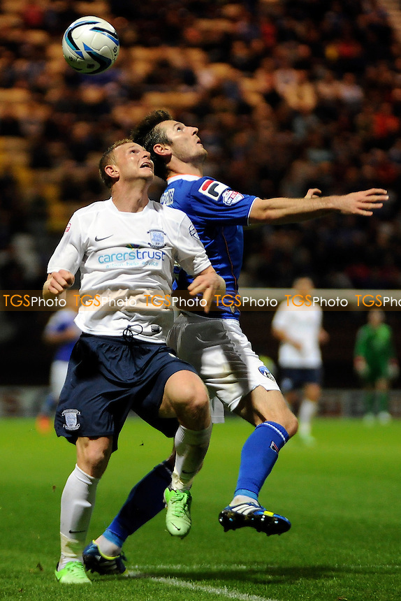 Stuart Beavon of Preston North End battles for the ball with Jonathan Grounds of Oldham Athletic - Preston North End vs Oldham Athletic - Sky Bet League One Football at Deepdale, Preston, Lancashire - 09/09/13 - MANDATORY CREDIT: Greig Bertram/TGSPHOTO - Self billing applies where appropriate - 0845 094 6026 - contact@tgsphoto.co.uk - NO UNPAID USE