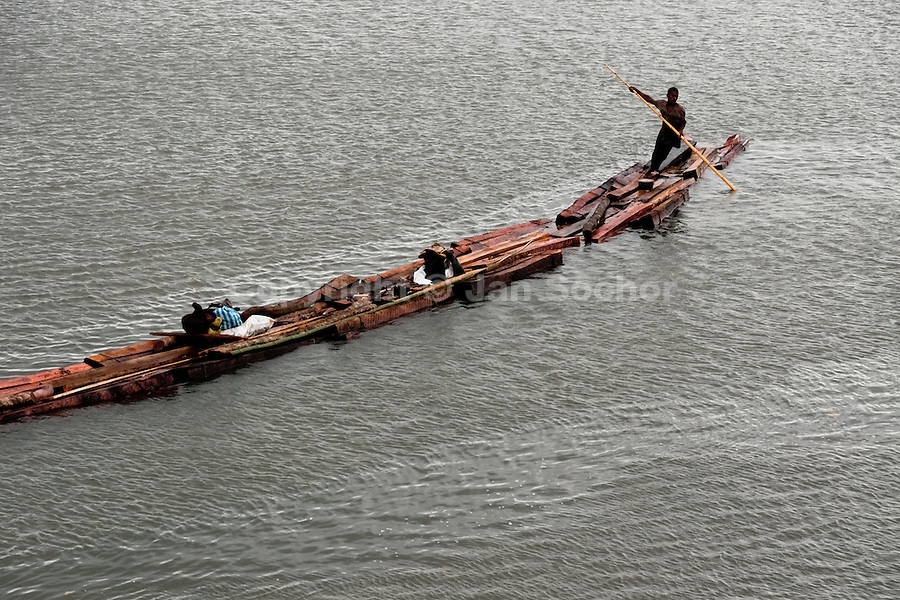 A Colombian logger floats timbers from the Pacific rainforest in a sea bay close to Tumaco, Colombia, 15 June 2010. Tens of sawmills located on the banks of the Pacific jungle rivers generate almost half of the Colombia's wood production. The wood species processed here (sajo, machare, roble, guabo, cargadero y pacora) are mostly used in the construction industry and the paper production. Although the Pacific lush rainforest in Colombia is one of the most biodiverse area of the world, the region suffers an extensive deforestation due to the uncontrolled logging in the last years.