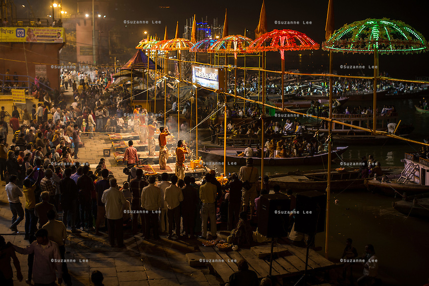 Aarti, a prayer offered to the River Ganges and a major nightly tourist attraction along the banks of the holy river Ganges in Varanasi, Uttar Pradesh, India on 15 November 2013. Guria runs a boat school targeting the boatmen's children, who are exposed and vulnerable to exploitation when they sell flowers and floating candles to the millions of tourists who come to Varanasi.