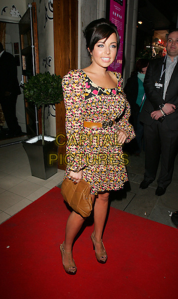 """LOUISA LYTTON.Launch Party for """"Orchid"""" Bar & Nightclub, Coventry Street, Piccadilly, London, England.April 16th 2008.full length brown bag purse hand on hip pattern black yellow print dress pink long sleeves .CAP/ROS.©Steve Ross/Capital Pictures."""