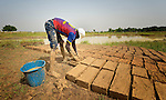 Jacuba Jarra makes bricks of mud which then dry in the hot African sun in Sonougouba, Mali, where the ACT Alliance has worked with local residents to encourage a sustainable economy, increase food security, and improve local governance.