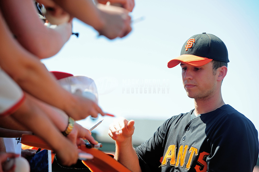 Mar. 28, 2012; Scottsdale, AZ, USA; San Francisco Giants first baseman Buster Posey signs autographs prior to the game against the Los Angeles Dodgers at Scottsdale Stadium.  Mandatory Credit: Mark J. Rebilas-