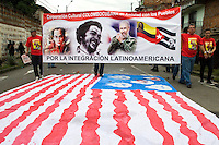 "A group of demonstrators protest in the celebration of May 1, International Day of the Work, carrying a cartel with the figures of the Che Guevara and of Fidel Castro with a legend that he says "" For the Latin-American integration "", treading on the flag of The United States. In Medellín, Colombia, May 1, 2012. Photo by Fredy Amariles/VIEWpress."