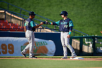 Lynchburg Hillcats left fielder Mitch Longo (10) fist bumps manager Rouglas Odor (24) during the first game of a doubleheader against the Frederick Keys on June 12, 2018 at Nymeo Field at Harry Grove Stadium in Frederick, Maryland.  Frederick defeated Lynchburg 2-1.  (Mike Janes/Four Seam Images)