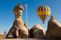 "Pictures & images of hot air balloons over the fairy a chimney rock Police Station at ""Pasaba Valley"" near Goreme, Cappadocia, Nevsehir, Turkey"