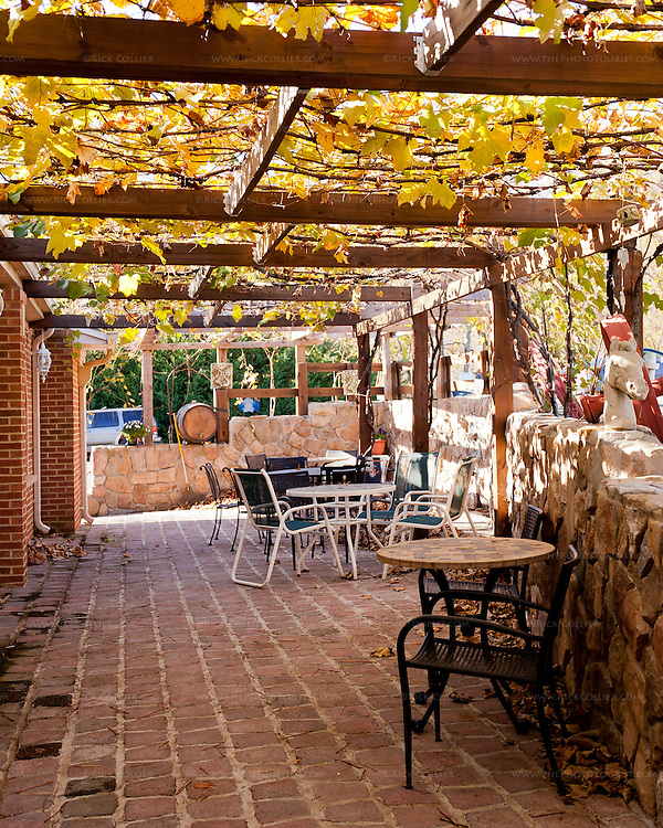 A covered side porch offers cozy seating under a grape arbor next to the tasting room at Mediterranean Cellars.