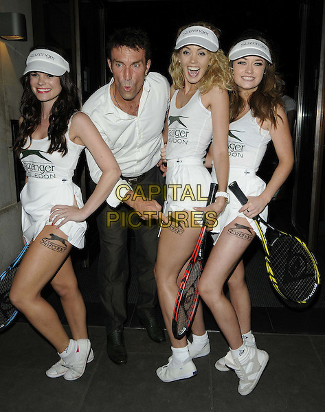 Pat Cash & models.The Slazenger Wimbledon Party, Aqua Nueva, Argyll St., London, England..June 28th, 2012.full length white shirt grey gray trousers white skirt tennis leg thigh tattoo hand finger pointing .CAP/CAN.©Can Nguyen/Capital Pictures.