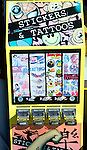 Vending machine selling stickers and tattoos, Scarborough, Yorkshire, England