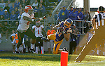 BROOKINGS, SD - OCTOBER 25:  Zach Zenner #31 from South Dakota State University makes a diving catch past Jaylin Kelly #40 from Youngstown State in the third quarter of their game Saturday afternoon at Coughlin Alumni Stadium in Brookings. (Photo by Dave Eggen/Inertia)