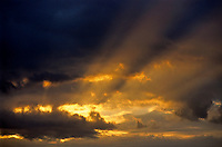 Sunbeams penetrating through heavy clouds at sunset, Marseille, France.